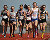Jennifer Mui, a seventh grader from Byram Hills, third from left (wearing number 3), passes the 200 meter mark along with her competition during the girls 3,000 meter run in the Cougar Invitational held at Bellmore JFK High School on Saturday, Apr. 16, 2016. Mui won the race with a time of 10:53.1.