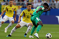 SAMARA - RUSIA, 28-06-2018: Lamine GASSAMA (Der) jugador de Senegal disputa el balón con James RODRIGUEZ (Izq) jugador de Colombia durante partido de la primera fase, Grupo H, por la Copa Mundial de la FIFA Rusia 2018 jugado en el estadio Samara Arena en Samara, Rusia. /  Lamine GASSAMA (R) player of Senegal fights the ball with James RODRIGUEZ (L) player of Colombia during match of the first phase, Group H, for the FIFA World Cup Russia 2018 played at Samara Arena stadium in Samara, Russia. Photo: VizzorImage / Julian Medina / Cont