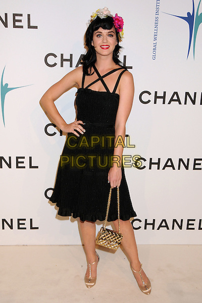 KATY PERRY.CHANEL Unveils New Boutique on Robertson Boulevard, Los Angeles, California, USA..May 29th, 2008.full length dress hand on hip gold bag purse quilted t-bar shoes black straps veil hat flowers floral pink green katie red lipstick  .CAP/ADM/BP.©Byron Purvis/AdMedia/Capital Pictures.