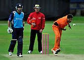 Cricket - 2nd One Day International - Scotland V The Netherlands at Mannofield - Aberdeen - Netherlands bowler Mudassar Bukhari took three Scots wickets though the match winning performance was by Scotland batsman Kyle Coetzer (left) making 89 not out - Umpire in Niels Bagh (Denmark) - Picture by Donald MacLeod - 29.6.11 - 07702 319 738 - www.donald-macleod.com