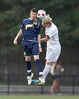 Quinnipiac University midfielder Tim Quigley (13) and Boston College midfielder Kyle Bekker (10) battle for head ball. Boston College defeated Quinnipiac, 5-0, at Newton Soccer Field, September 1, 2011.