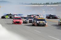 Apr 26, 2009; Talladega, AL, USA; NASCAR Sprint Cup Series driver Jeff Burton (31) leads Tony Stewart (14) as Jimmie Johnson (48), Juan Pablo Montoya (42) and Bobby Labonte (96) crash during the Aarons 499 at Talladega Superspeedway. Mandatory Credit: Mark J. Rebilas-