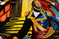 The Haiti Revolution leader Toussaint L'Ouverture painted on the body of a tap-tap bus operating in Port-au-Prince, Haiti, 26 July 2008. Tap-tap vehicles serve as public transportation in Haiti. They are private, operate over fixed routes, departing only when full. Tap-taps are decorated with bright and shiny colors and with a lot of fancy designed elements. There are scenes from the Bible, Christian slogans, TV stars or famous football players often painted on a tap-tap body. Tap-tap name comes from sound of taps on the metal bus body signifying a passenger's request to be dropped off.