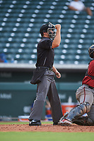 Home plate umpire Sean Sparling calls a strike during an Arizona League game between the AZL D-backs and AZL Cubs 1 on July 25, 2019 at Sloan Park in Mesa, Arizona. The AZL D-backs defeated the AZL Cubs 1 3-2. (Zachary Lucy/Four Seam Images)