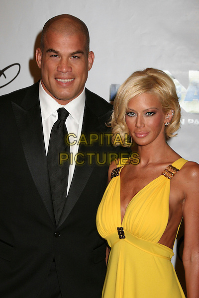 "JENNA JAMESON & GUEST.17th Annual ""Night of 100 Stars"" Oscar Gala at the Beverly Hills Hotel, Beverly Hills, California , USA. .February 25th, 2007.half length black suit jacket yellow dress.CAP/ADM/BP.©Byron Purvis/AdMedia/Capital Pictures"