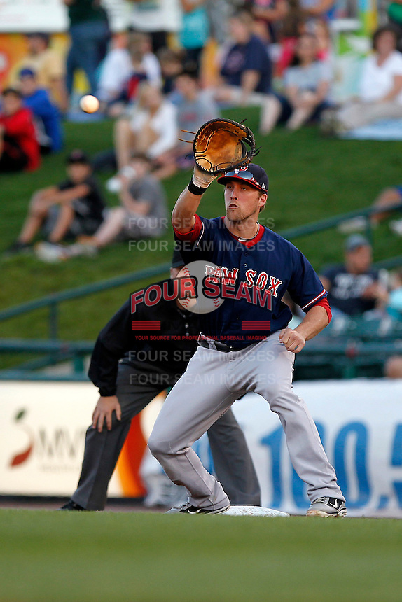 Pawtucket Red Sox first baseman Lars Anderson #26 takes a pickoff throw during a game against the Rochester Red Wings at Frontier Field on August 30, 2011 in Rochester, New York.  Rochester defeated Pawtucket 8-6, umpire David Soucy is in the background.  (Mike Janes/Four Seam Images)