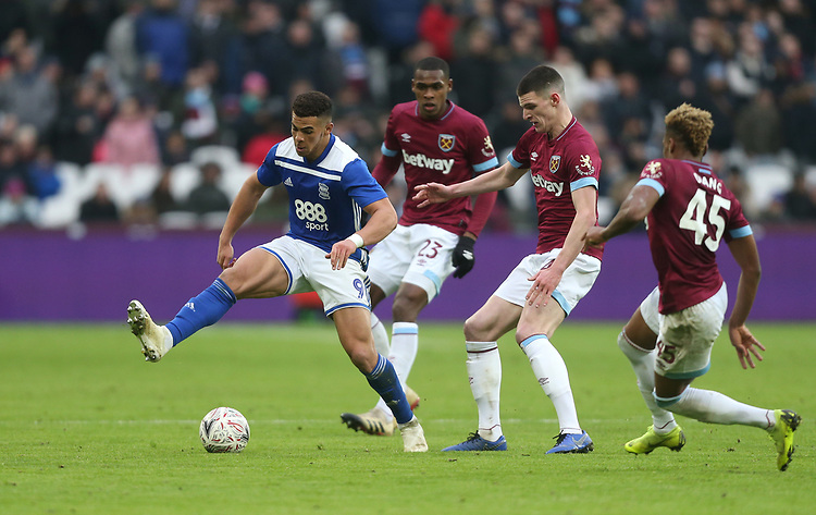 Birmingham City's Che Adams surrounded by West Ham United's Declan Rice, Issa Diop and Grady Diangana<br /> <br /> Photographer Rob Newell/CameraSport<br /> <br /> Emirates FA Cup Third Round - West Ham United v Birmingham City - Saturday 5th January 2019 - London Stadium - London<br />  <br /> World Copyright © 2019 CameraSport. All rights reserved. 43 Linden Ave. Countesthorpe. Leicester. England. LE8 5PG - Tel: +44 (0) 116 277 4147 - admin@camerasport.com - www.camerasport.com