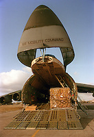 A U.S. Airforce C-5 cargo jet sits on the tarmac waiting to be unloaded after it's arrival in Mogadishu, Somalia in support of Operation Restore Hope in 1993.  At the time, the aircraft was the largest cargo aircraft in the world. The C-17 more recently put into service may now surpass the C-5.