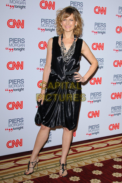 KATIE DERHAM.The launch of CNN's 'Piers Morgan Tonight' at the Mandarin Oriental Hotel, London, England..December 7th, 2010.full length black dress hand on hip sleeveless .CAP/CJ.©Chris Joseph/Capital Pictures.
