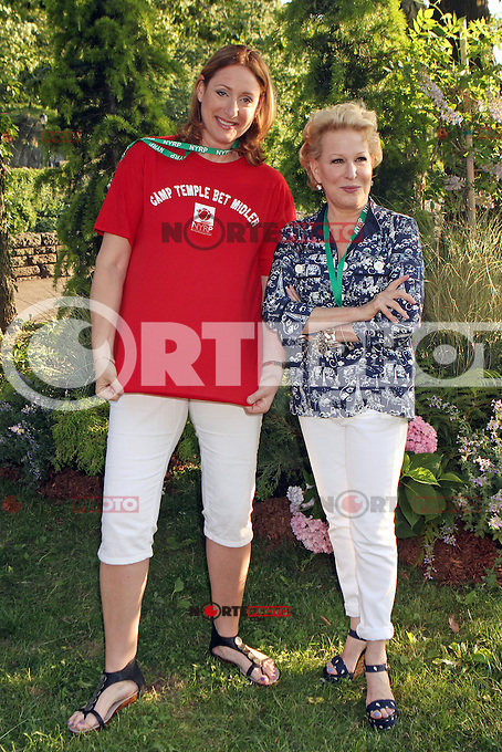 Judy Gold and Bette Midler attending Bette Midler's New York Restoration Project's 11th annual Spring Picnic on The Cloisters Lawn at Fort Tryon Park in New York, 31.05.2012..Credit: Rolf Mueller/face to face /MediaPunch Inc. ***FOR USA ONLY***