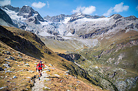 Trail running above Zermatt, Switzerland with the Zinalrothorn in the distance.