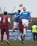 Kyle Hutton and Seb Faure going for the ball