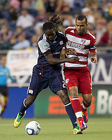 New England Revolution midfielder Shalrie Joseph (21) disrupts FC Dallas forward Maicon Santos (9) drive forward. In a Major League Soccer (MLS) match, the New England Revolution defeated FC Dallas, 2-0, at Gillette Stadium on September 10, 2011.