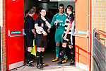 Referee Aaron Bannister prepares to lead the teams out. Darlington 1883 v Southport, National League North, 16th February 2019. The reborn Darlington 1883 share a ground with the town's Rugby Union club. <br /> After several years of relegations, bankruptcies, and ground moves, the club is fan owned, and back on an even keel in the National League North.<br /> A 0-0 draw with Southport was marred by a broken leg and dislocated knee suffered by Sam Muggleton, Darlington's on loan left back.<br /> Both teams finished the season in lower mid table.