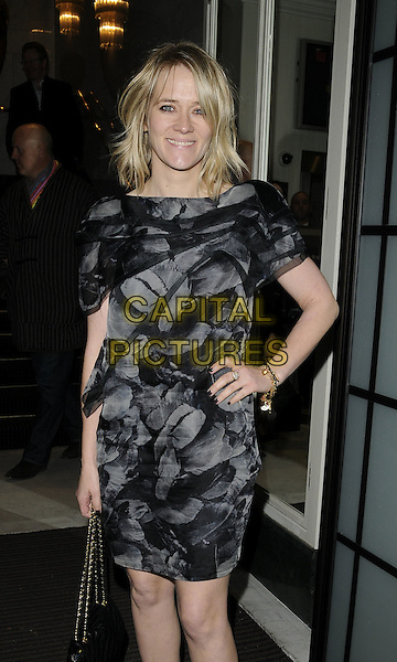 EDITH BOWMAN .Charity Screening of 'Nowhere Boy' held at BAFTA Piccadilly, London, England. .November 26th, 2009 .half 3/4 length black top grey gray pattern print dress hand on hip.CAP/CAN.©Can Nguyen/Capital Pictures.