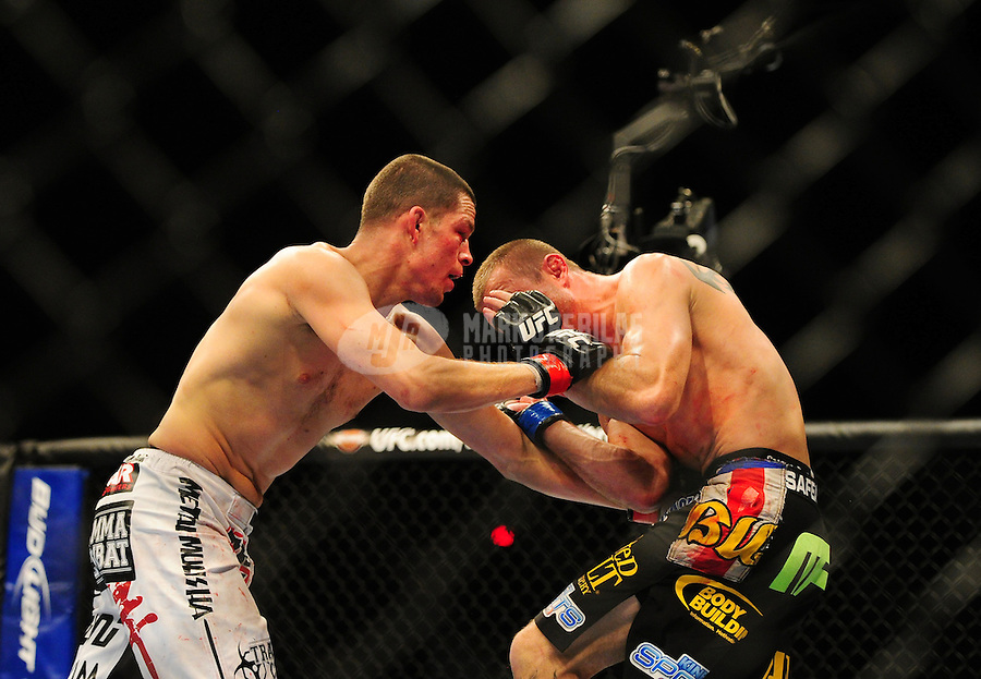 Dec 30, 2011; Las Vegas, NV, USA; UFC fighter Nate Diaz (left) against Donald Cerrone during a lightweight bout at UFC 141 at the MGM Grand Garden event center. Mandatory Credit: Mark J. Rebilas-