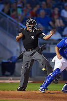 Umpire Nestor Ceja makes a strike three call during a game between the Midland RockHounds and Tulsa Drillers on June 2, 2015 at Oneok Field in Tulsa, Oklahoma.  Midland defeated Tulsa 6-5.  (Mike Janes/Four Seam Images)