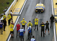 Mar. 9, 2012; Gainesville, FL, USA; Crew members look on as NHRA pro stock driver Jeg Coughlin launches off the starting line during qualifying for the Gatornationals at Auto Plus Raceway at Gainesville. Mandatory Credit: Mark J. Rebilas-
