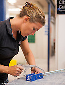 Female trainee tiler,  Able Skills training centre, Dartford, Kent.