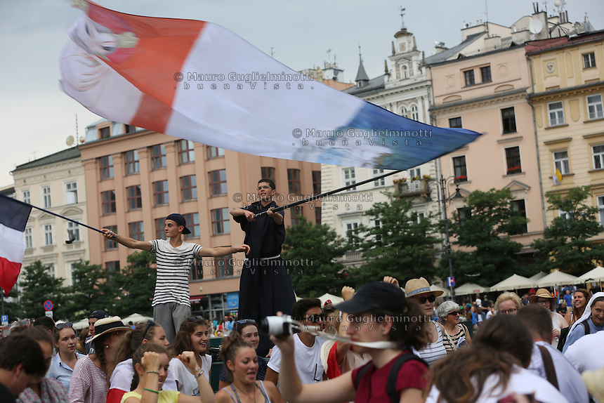 World Youth day Krakow 2016<br /> <br /> Frate e un giovane sventolano  bandiere francesi