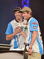 NWA Democrat-Gazette/BEN GOFF -- 04/26/15 Tyler Black  (left) and North Carolina teammate Kristopher Queen react after being named the 2015 High School Fishing National Champions during final weigh-ins for the tournament at the John Q. Hammons Center in Rogers on Sunday Apr. 26, 2015.