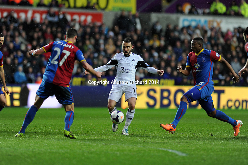 Swansea city's Leon Britton looks for a gap. Barclays Premier league, Swansea city v Crystal Palace match at the Liberty Stadium in Swansea, South Wales on Sunday 2nd March 2014.