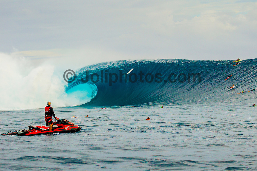 CLOUDBREAK, Tavarua/Fiji (Friday, June 8, 2012) – Big wave rider Mark Healey (HAW)has taken off his leach and tried to duck dive this massive wave. A trail of bubbles from his frantic efforts are in the face of the wave as his 9' surfboard floats up the face. Both the board and Healey made it through and over the wave .  The best day of paddle surfing ever seen at Cloudbreak happen today with the swell in the15'- 30' range from the south.  The surf pumped all day with amazing performances from of the world best big wave paddle in surfers.  Photo: joliphotos.com