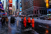Workers clean snow from the street of Times Square after the pass of the winter storm JONAS, in New York, 01/24/2016. Photo by VIEWpress