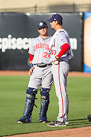 Hagerstown Suns pitching coach Sam Narron (43) chats with catcher Spencer Kieboom (20) prior to the game against the Greensboro Grasshoppers at NewBridge Bank Park on June 21, 2014 in Greensboro, North Carolina.  The Grasshoppers defeated the Suns 8-4. (Brian Westerholt/Four Seam Images)