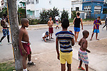 HAVANA, CUBA -- MARCH 22, 2015:   Kids play in the Vedado neighborhood of Havana, Cuba on March 22, 2015. Photograph by Michael Nagle