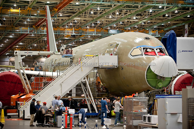 4/30/2009--Everett, WA, USA...At Boeing's Everett, Wash., the first Boeing 787s are under production. Boeing expects the first test flight for the aircraft in the second quarter of 2009...The 787-8 Dreamliner will carry 210 - 250 passengers on routes of 7,650 to 8,200 nautical miles (14,200 to 15,200 kilometers), while the 787-9 Dreamliner will carry 250 - 290 passengers on routes of 8,000 to 8,500 nautical miles (14,800 to 15,750 kilometers).  A third 787 family member, the 787-3 Dreamliner, will accommodate 290 - 330 passengers and be optimized for routes of 2,500 to 3,050 nautical miles (4,600 to 5,650 kilometers). ..In addition to bringing big-jet ranges to mid-size airplanes, the 787 will provide airlines with unmatched fuel efficiency, resulting in exceptional environmental performance. The airplane will use 20 percent less fuel for comparable missions than today's similarly sized airplane. It will also travel at speeds similar to today's fastest wide bodies, Mach 0.85. Airlines will enjoy more cargo revenue capacity. Passengers will also see improvements with the new air..Photograph ©2009 Stuart Isett.All rights reserved
