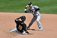Carlos Asuaje (2) of the El Paso Chihuahuas  starts the double play with a sliding Quintin Berry (19) of the Salt Lake Bees during the game in Pacific Coast League action at Smith's Ballpark on April 24, 2016 in Salt Lake City, Utah. This was Game 1 of a double-header.  El Paso defeated Salt Lake 7-0. (Stephen Smith/Four Seam Images)