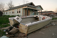 New Orleans, LA--A boat sits on the sidewalk, guarding row after row of abandoned houses in the hard-hit 9th Ward. Liam Maloney / Special to The Gazette