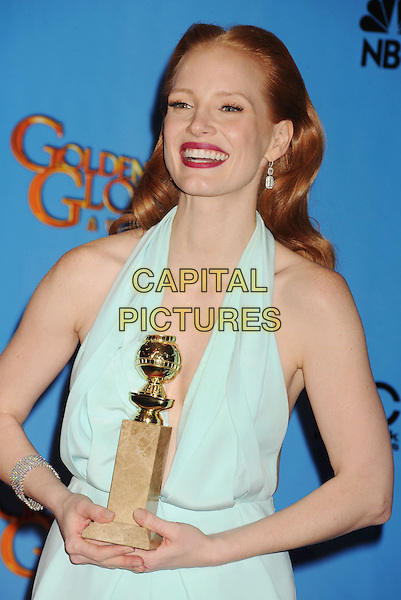 Jessica Chastain.Press Room at the 70th Annual Golden Globe Awards held at the Beverly Hilton Hotel, Beverly Hills, California, USA..January 13th, 2013.globes half length blue halterneck red lipstick plunging neckline award trophy winner smiling .CAP/GAG.©GAG/Capital Pictures