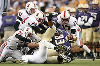 11 November 2006: Wopamo Osaisai, Tom McAndrew, Trevor Hooper, and Carlos McFall make a tackle during Stanford's 20-3 win over the Washington Huskies in Seattle, WA.