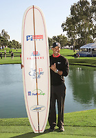 28 JAN 13  Tiger Woods with his 1st prize surfboard after Monday's Final round of The Farmers Insurance Open at The Torrey Pines Golf Course in La Jolla, California.(photo:  kenneth e.dennis / kendennisphoto.com)