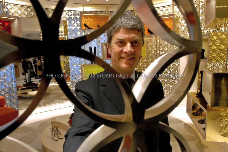 "10/9/2005--Paris, France..Louis Vuitton president Yves Carcelle poses in the women's shoe section of the Louis Vuitton store.  French luxury goods maker Louis Vuitton opened its biggest store yet on the Champs Elysees in Paris, after a 20-month redesign and enlargement project. The flagship store at 101, avenue des Champs Elysees has been redecorated and enlarged at an undisclosed cost...About 300 VIPs, including Hollywood stars Sharon Stone and Uma Thurman and French actress Catherine Deneuve, attended the official opening before American designer Marc Jacobs unveils his ready-to-wear spring-summer 2006 collection for Louis Vuitton. Behind the face-lift are US architects Eric Carlson and Peter Marino who sought to create a feeling of the famous promenade along the Champs Elysees continuing into the store...Throughout, it has features alluding to aspects of the fabled Champs Elysees such as brown and beige limestone flooring which echoes the paving stones on the street outside. Features include a light sculpture by American James Turrell, a 20-metre (65 feet) long ""travelling staircase"" showcasing the work of American video artist Tim White-Sobieski and an elevator linking the store to the top floor by Denmark's Olafur Eliasson..Photograph By Stuart Isett.All photographs ©2005 Stuart Isett.All rights reserved."