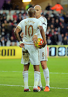 Andre Ayew of Swansea has the ball grabed by team mate Jonjo Shelvey who took the penalty during the Barclays Premier League match between Swansea City and Bournemouth at the Liberty Stadium, Swansea on November 21 2015