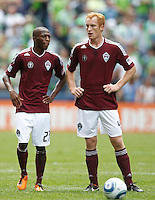 Colorado Rapids forward Sanna Nyassi, left, and midfielder Jeff Larentowicz during play against the Seattle Sounders FC at CenturyLink Field in Seattle Saturday July 17, 2011. The Sounders won the game 4-3.