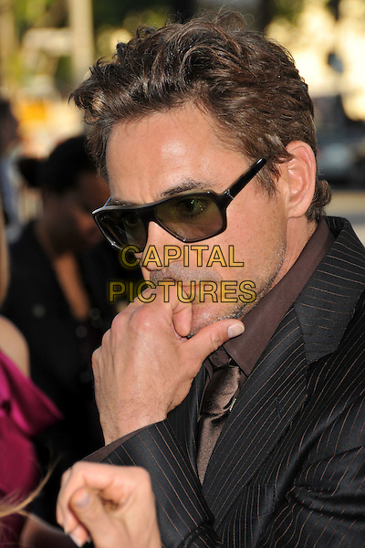 "ROBERT DOWNEY JR..""Orphan"" Los Angeles Premiere held at Mann's Village Theatre, Westwood, CA, USA..July 21st, 2009.headshot portrait sunglasses shades black stubble facial hair hand.CAP/ADM/BP.©Byron Purvis/AdMedia/Capital Pictures."