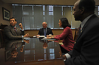 Illinois State Treasurer Alexi Giannoulias, Illinois Governor Pat Quinn, Illinois State's Attorney Lisa Madigan and Illinois Secretary of State Jesse White meet with Quinn during his first day in office at the Thompson Center on January 30, 2009.  The day before, the Illinois State Senate voted to impeach Quinn's predecessor, Rod Blagojevich.