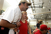 Hythem Salem gives his son Sam a word of encouragement before his wrestling match in the gym at the Pennridge High School in Perkasie, Pa.  in which twins Jake and Sam compete. The Salem children, 3 sets of twins, are from Russia. Sophia and twin Joseph were adopted at 11 months of age by Hythem and his wife Lisa. The other twins were adopted just 20 months ago. All children are thriving in school and socially. photo by jane therese