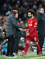 30th November 2019; Anfield, Liverpool, Merseyside, England; English Premier League Football, Liverpool versus Brighton and Hove Albion; Mohammed Salah of Liverpool shakes hands with Liverpool manager Jurgen Klopp as he is substituted  - Strictly Editorial Use Only. No use with unauthorized audio, video, data, fixture lists, club/league logos or 'live' services. Online in-match use limited to 120 images, no video emulation. No use in betting, games or single club/league/player publications