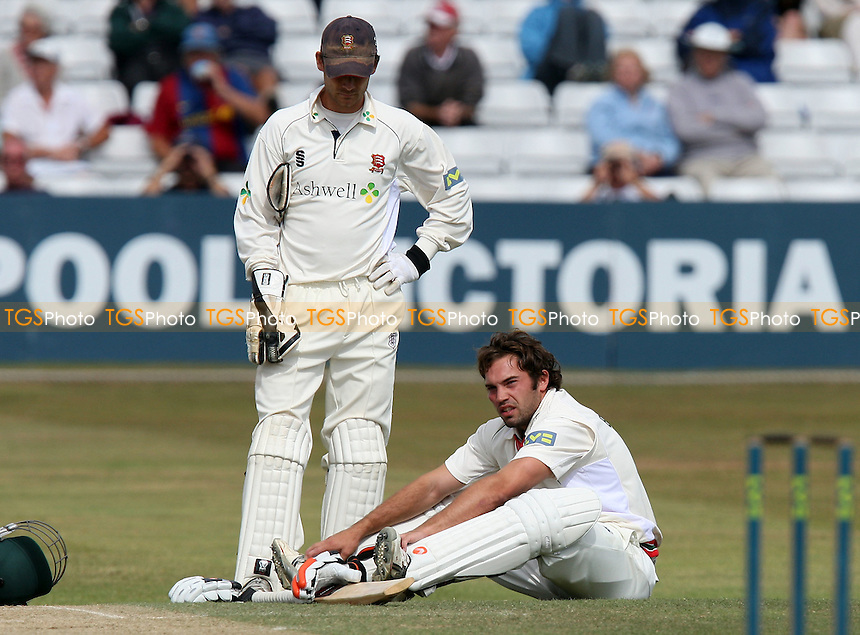 James Benning (sitting) of Leicestershire is hit in the face by a David Masters bouncer and retires hurt from the game. Essex wicket keeper James Foster looks on - Essex CCC vs Leicestershire CCC - LV County Championship Division Two Cricket at the Ford County Ground, Chelmsford -  28/08/09 - MANDATORY CREDIT: Gavin Ellis/TGSPHOTO - Self billing applies where appropriate - Tel: 0845 094 6026
