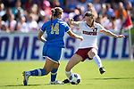 ORLANDO, FL - DECEMBER 03: Andi Sullivan #17 of Stanford University defends Olivia Athens #14 of UCLA during the Division I Women's Soccer Championship held at Orlando City SC Stadium on December 3, 2017 in Orlando, Florida. Stanford defeated UCLA 3-2 for the national title. (Photo by Jamie Schwaberow/NCAA Photos via Getty Images)