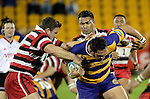 Kristian Ormsby & Taiasina Tuifua tackle ex Counties Manukau player James Afoa. Counties Manukau Steelers vs Bay of Plenty Steamers warm up game played at Mt Smart Stadium on 14th of July 2006. Counties Manukau won 25 - 20.