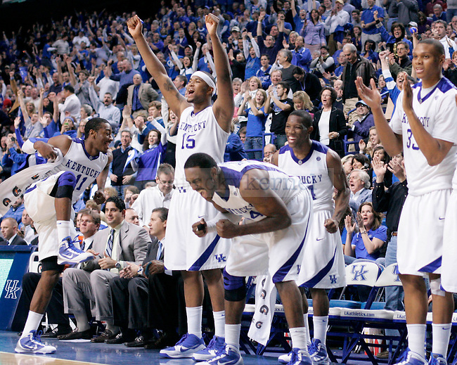 The Wildcats cheer for their teammates during the second half of the game agaisnt the Razorbacks at Rupp Arena on Saturday. The Cat's defeated the Razorbacks 101-70, making them the No. 1 team in the nation. Photo by Zach Brake | Staff..