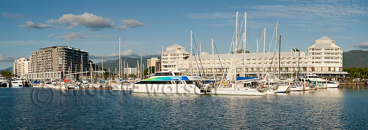 Tourist boats at Marlin Marina with city skyline in background. Cairns, Queensland, Australia