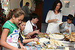 Mexican/Italian girls and their extended family make tamales at a family Tamalada (tamale making party), Torrance, CA