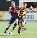 Livy's Connor McDonald challenges Alloa's Graeme Holmes.